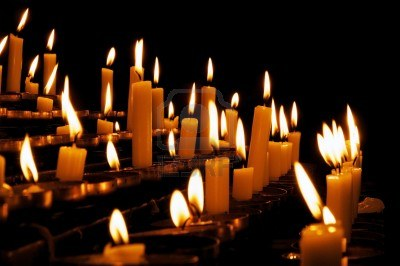 10576839-burning-prayer-candles-in-a-catholic-church-in-europe
