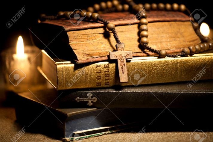 26580212-Old-Holy-Bibles-Rosary-Beads-and-Candles--Stock-Photo